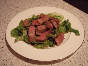 Steak with parm butter over arugula